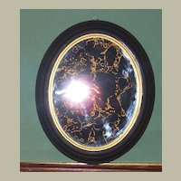 Mirror Marbelized in Gold Leaf set in Black and Gold Oval Frame