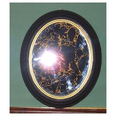 Mirror Marbelized in Gold Leaf set in Black and Gold Oval Frame