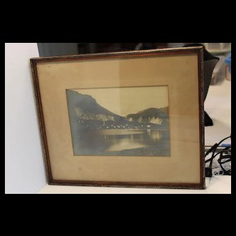 Framed photo of lake with mountains