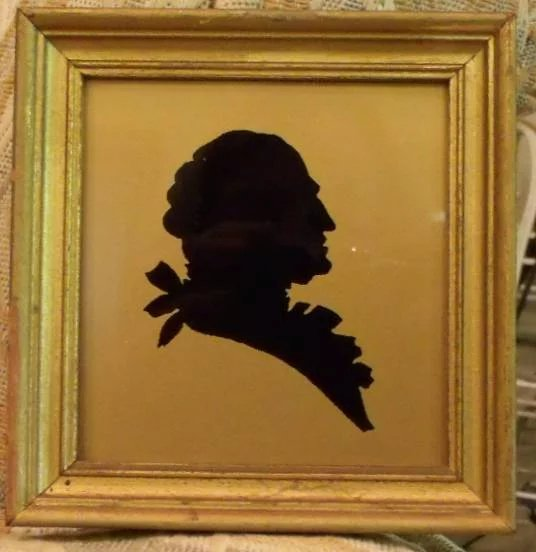 Silhouette Of Martha And George Washington Under Glass On