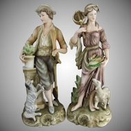 Bisque Porcelain Figures of a 18th Century Gardener with Dog & Shepherdess with Sheep