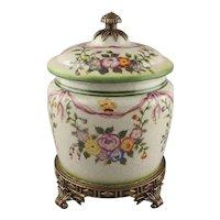 A Porcelain Craquelure Glaze Floral Enameled Bronze Mounted Jar & Cover