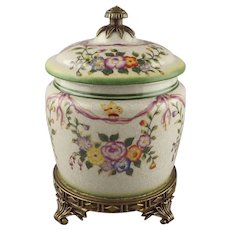A Porcelain Craquelure Glaze Floral Enameled Bronze Mounted Jar & Cover