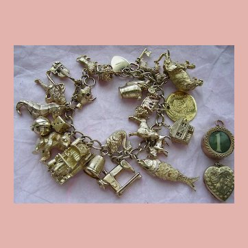 Wonderful 9k Loaded Charm Bracelet circa 1960 Rare Charms 98 grams!