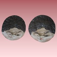 Pair Of Asian Funny Faced Pottery Butter Pats
