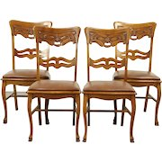 Set of 4 Antique North Wind Carved Oak Dining or Game Chairs, Leather Seats