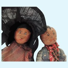 Pair of Wood Bodied Nut Head Dolls In Original Outfits