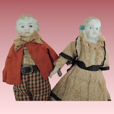 Pair Brother and Sister Bisque Head Dolls In Original Clothes