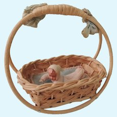 Sweet Little Caco Baby In Rocking Wicker Cradle