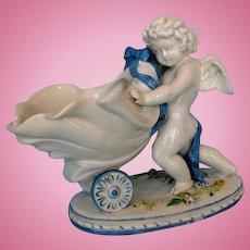 19th Century German Porcelain Winged Cupid with Cornucopia