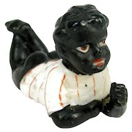 Small Child Black Bisque Figurine Laying Down Vintage