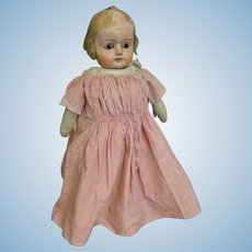 22-Inch antique Papier mache head doll Germany 1880s Cloth body, early dress