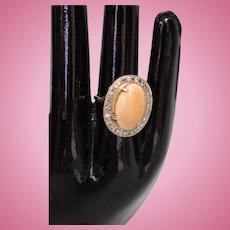 Stunning Vintage 14 Karat Yellow Gold large oval shaped Opal surrounded by diamonds Fashion