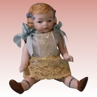 Antique 4 inch all bisque doll Molded hair and hair bows Painted eyes c.1920