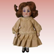 Antique 4 inch closed mouth all bisque Dollhouse Doll