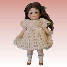 """4-1/2"""" All Bisque doll 607 Germany with sleep eyes and one strap molded shoes"""