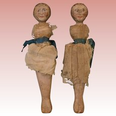 "Two 9"" Hand Painted wooden dolls with Painted faces and hair"