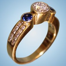 Sleek and Modern 18k Yellow Gold Ring w 65 Point Diamond and two Blue Sapphires