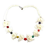 Tropical Necklace of Shell Clusters