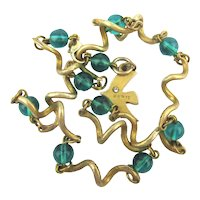 CECILE JEANNE Paris Gilt Coiled Links Necklace w/ Emerald Glass