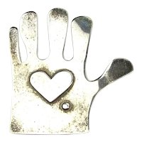 A Heart in the Hand is Worth a Pin on Your Jacket