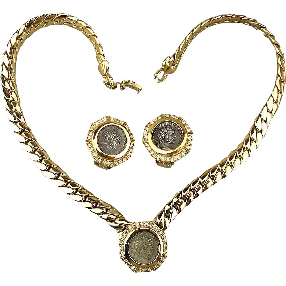 motif filles twin glamorous necklace featuring with medallion au roman charm gun coin in bracelet revoir fob gold intaglio colt les interlocking guns luxe bye biddy a products
