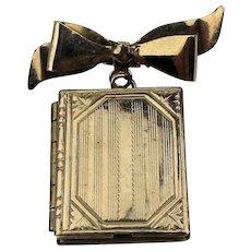 It's a Pin. It's a Locket. It's a Book. It's Sterling Silver.