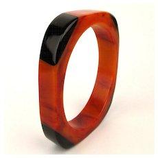 c1930s Orange Swirl Bakelite Bangle Bracelet w/ Black Corners