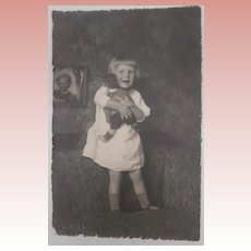 Early Photo Postcard , Child with Steiff Doll