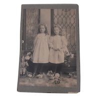 Early Photograph of Two Sisters and a Doll