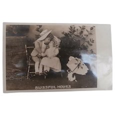 Early Postcard 'Blissful Hours' Bisque Dolls