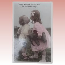 Sweet Early Postcard Boy and Girl with a lovely Early Elephant.