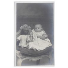 Early Photo Postcard Baby with Teddy Bear