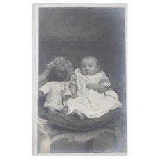 Early Photo Postcard Baby with Teddy Bear
