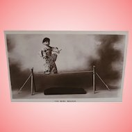 Early Postcard  Real Photo Oriental Doll on Wire