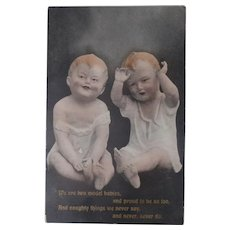 Unusual Early Postcard Bisque Piano Baby Dolls