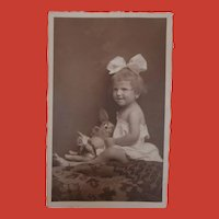 Vintage REal Picture Postcard Little Girl with her Doll and  Comical Toy Dog