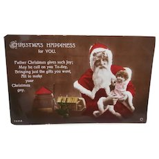 Santa Claus Christmas Postcard with Doll