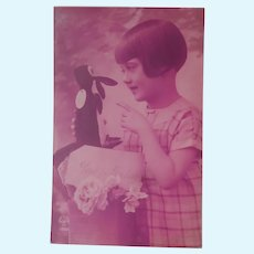 Early Postcard , Girl with her Comical  Toy Penguin