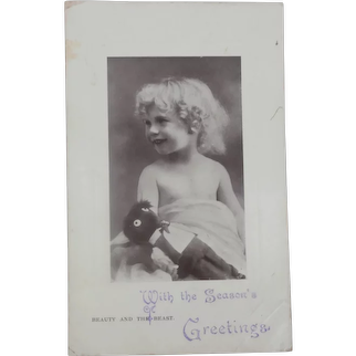 Early Tuck Postcard, Girl with Black Cloth Doll.