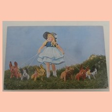Wonderful Mutzipuppen Postcard with Cloth Doll and Bull Dogs. 1930's