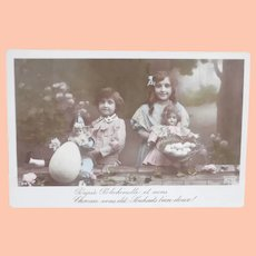 Early French Easter Postcard with a Flirty Eye Doll 1910