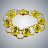 Bright Gold Tone Art Deco Flower Bracelet with Emerald Green Cabochons