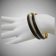 Set of Black Enamel and Gold Tone Bangles by Monet