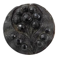 Victorian mourning black glass button with metal shank.  Flower design.