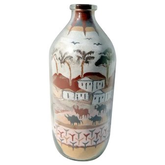 Vintage sand art bottle with cattle and farm scene