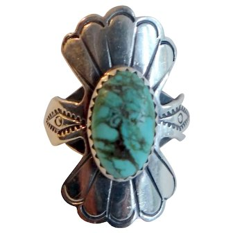Navajo sterling silver ring with turquoise cabochon and stamping
