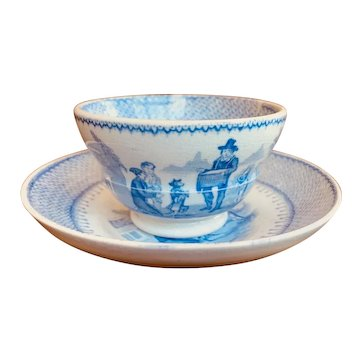 """Child's Transferware Tea Bowl and Saucer in the """"Organ Grinder"""" Pattern"""