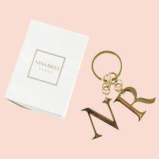 Shiny brass Nina Ricci NR or RN initial couture key chain