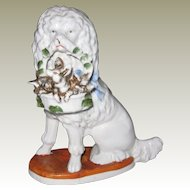 Staffordshire Pottery Figure of Poodle with a Basket of Piglets